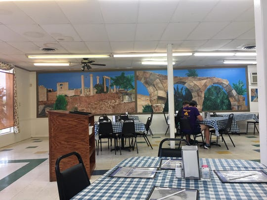 Greek Corner Mediterranean Restaurant is decorated with several murals on its walls.