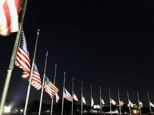 Miraculously my walk ended in a circle of American flags, humbly bowed to half-staff which seemed to me to be encircling those who were weeping and mourning and suffering.