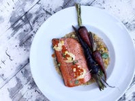 Salmon served with a creamed corn sauce