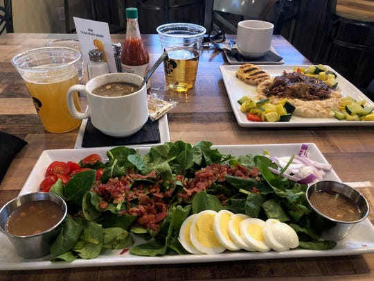 The salad with bacon, red onion, tomato, and boiled egg served with sweet hot bacon dressing was both beautiful and satisfying.