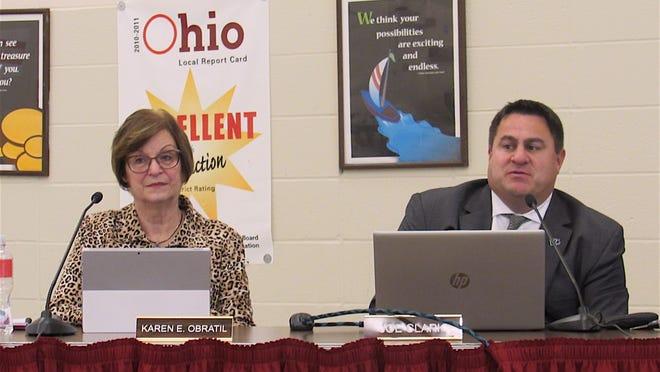 Treasurer Karen Obratil and Superintendent Joe Clark discussion district finances in 2018.
