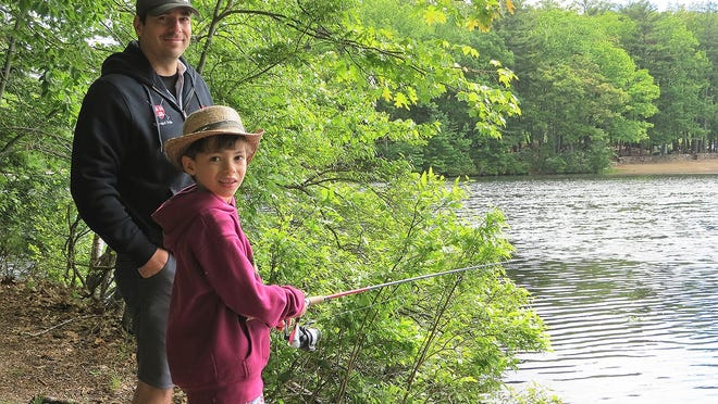 Robin Reyes and his dad from Cambridge enjoy a peaceful morning of fishing at Dunn Pond.