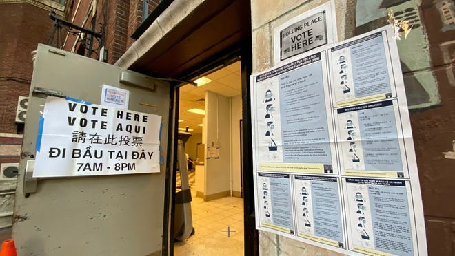 A poster instructing proper facemask use was taped at the entrance of a polling location Tuesday in the Nazzaro Community Center in Boston's North End.