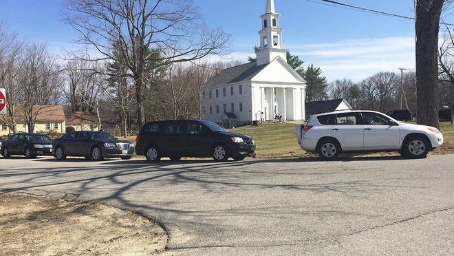 Residents sit in their cars at the Phillipston town common to hear the Easter Sunday service broadcast by the Rev. Stephanie Flynn of the Congregational Church of Phillipston on April 12. TGN file photo]
