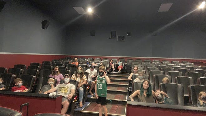 """Richie Archer, 11, (center, standing) was treated to a surprise birthday screening of """"E.T. the Extra-Terrestrial"""" at Gardner Cinemas on Friday, July 24. Co-owner Chris Daigle said he would make select movies available for private screenings up to 25 people until theaters are able to show new Hollywood releases."""