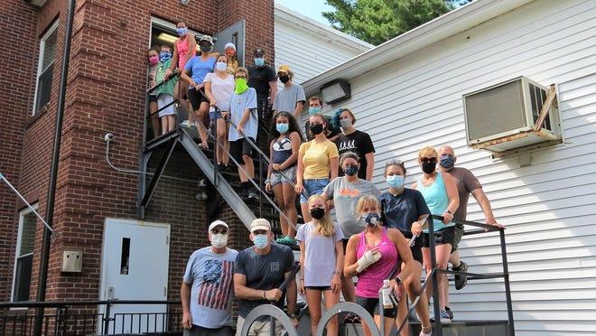 Volunteers are shown outside CAC food pantry in Gardner last summer.