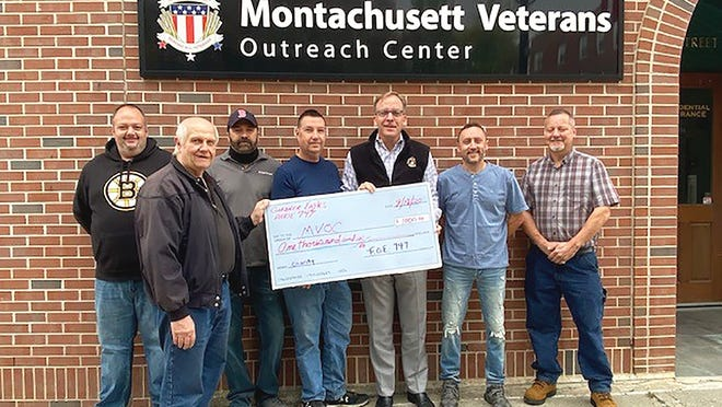 Charles Murphy, executive director of the Montachusett Veterans Outreach Center in Gardner, center, accepts a $1,000 donation from Gardner Fraternal Order of Eagles members Tim Beauregard, Shawn Moriarty, Jim Lovewell, David Dragon, Jay Austin and Brian Marr.