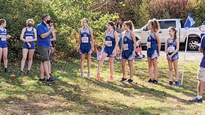 Murdock cross country coach Anthony Findley, third from left, explains the course rules to the Blue Devils and visiting Narragansett Warriors before the start of the girls' meet, Thursday afternoon, at Winchendon Community Park.