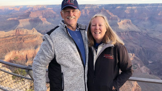 Eric Holmlund, a 2008 inductee of the Narragansett Athletic Hall of Fame, and his wife, Judy, pictured on one of their recent trips to the Grand Canyon. A celebrated runner during his high school days, Holmlund now enjoys scuba diving, fishing and is a green belt in Shotokan Karate.