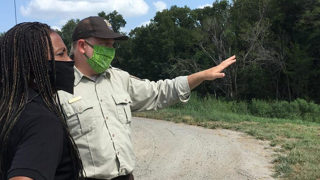 Wildlife Biologist Chuck Hayes describes ongoing work on a water control structure to US FWS Director Aurelia Skipwith, who visited the Savannah National Wildlife Refuge Thursday.
