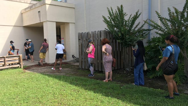 The line at the Salvation Army on Bee Road hugged the building for shade as voters waited more than an hour to cast their ballots.