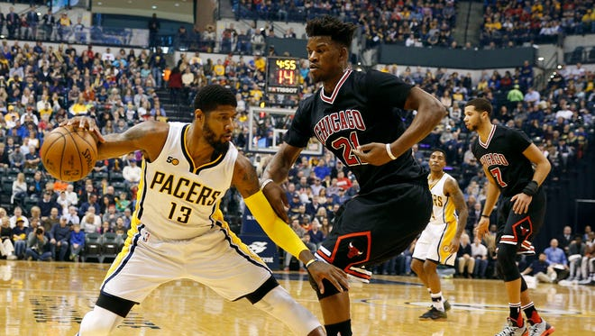 Dec 30, 2016; Indianapolis, IN, USA; Indiana Pacers forward Paul George (13) is guarded by Chicago Bulls guard Jimmy Butler (21) at Bankers Life Fieldhouse.