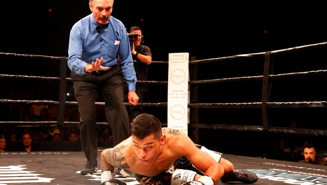 Referee Rocky Burke counts out Jorge Lara just 33 seconds into the first round of his scheduled 10 round fight against Claudio Marrero at the Don Haskins Center. Lara was never able to get up from the canvas and Marrero pushes his record to 23-2 (17 KO's.)