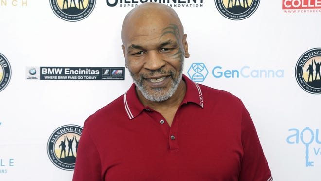 Former heavyweight champion Mike Tyson will returning to boxing Sept. 12 with an exhibition against Roy Jones Jr.