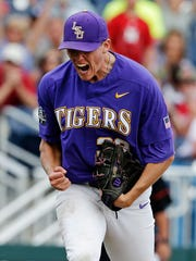 LSU pitcher Zack Hess (38) celebrates after an NCAA College World Series baseball game against Oregon in Omaha, Neb., Friday, June 23, 2017. LSU won 3-1.