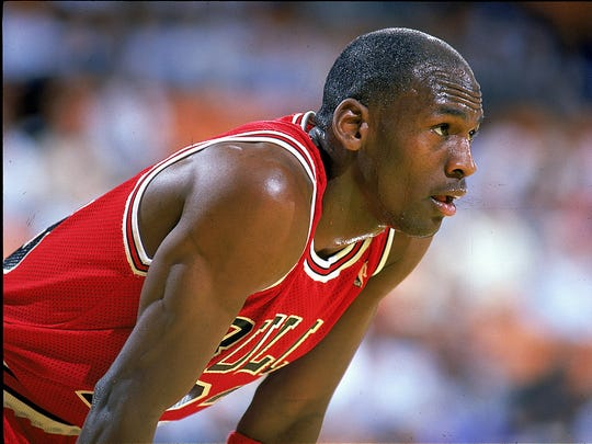 A close up of Michael Jordan as he looks on during a 1989 game.