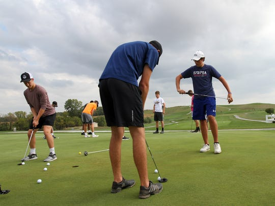 Cedar Rapids Prairie's Ian Johnston, right, practices with teammates at Airport National Golf Course in Cedar Rapids on Wednesday, Sept. 20, 2017. Johnston started fundraising for the Area Substance Abuse Council after his brother, Seth Carnicle, died from a heroin overdose in October 2016.
