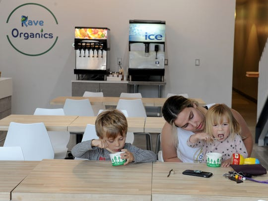 Caden Harrison, 4 1/2, along with his sister Kelsey Harrison, 2, and their babysitter eat frozen yogurt at Rave Organics Cafe in Thousand Oaks.