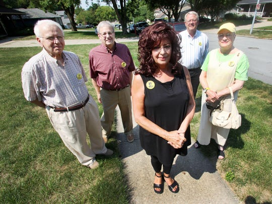 Noreen Gosch, center, and others gathered recently in West Des Moines where her son Johnny was last seen in 1982.