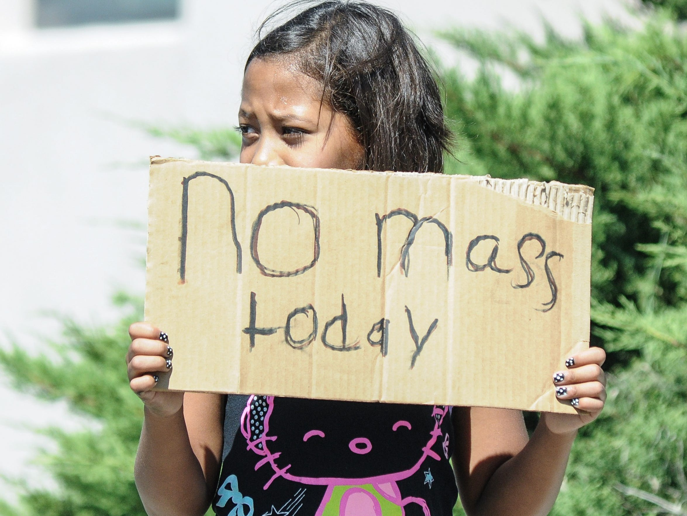 Aaliyah Dominguez, 11, stands on North Alameda Boulevard