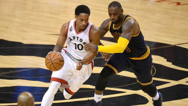 May 21, 2016; Toronto, Ontario, CAN; Toronto Raptors guard DeMar DeRozan (10) dribbles the ball past Cleveland Cavaliers forward LeBron James (23) in game three of the Eastern conference finals of the NBA Playoffs at Air Canada Centre. Mandatory Credit: Dan Hamilton-USA TODAY Sports