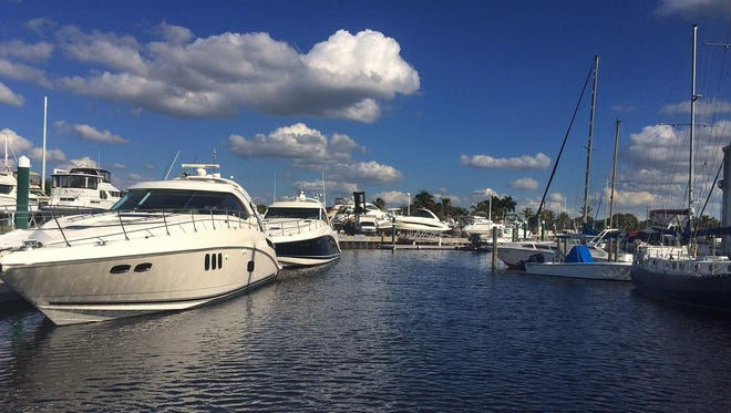 Boats sit docked at Deep Lagoon Marina, recently purchased by MarineMax.