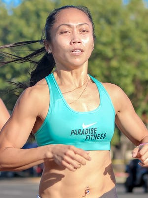 Rhea Macaluso is the first female finisher at Guam Running Club's Liberation Day Mile Run on July 21.