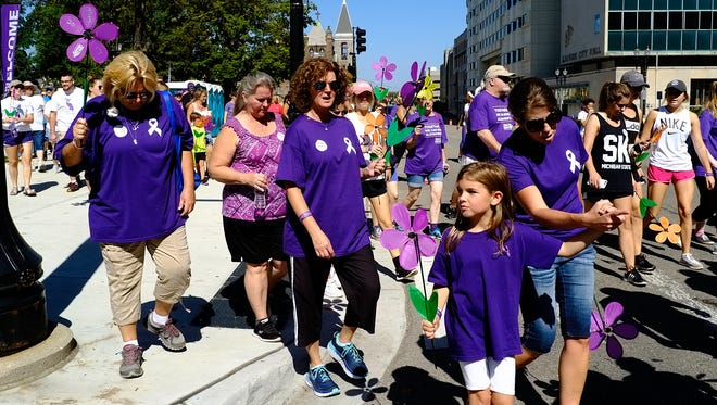 About 1,500 people participate in the 2017 Lansing Walk to End Alzheimer's Sunday, Sept. 24, 2017.