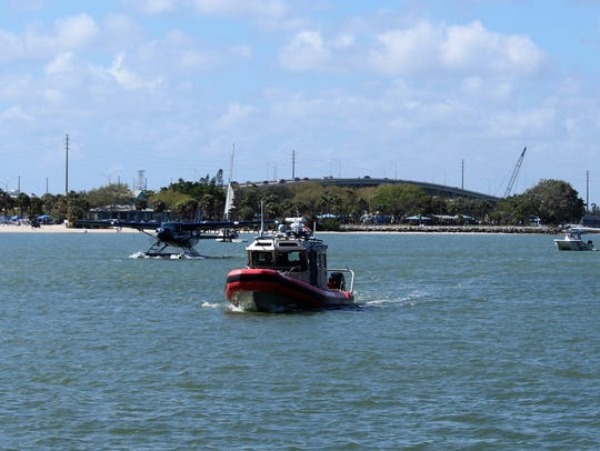 United States Coast Guard escorted Fly the Whale seaplanes.