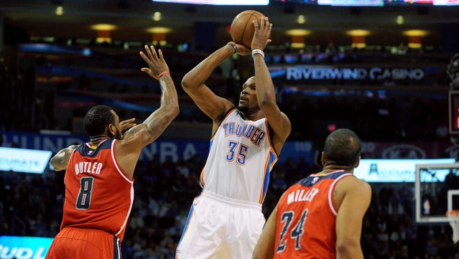 Kevin Durant attempts a shot against Wizards forward Rasual Butler.