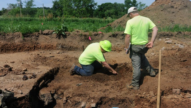 Thomas Grooms, Archaeology Transportation Reviews Manager at Ohio History Connection, left, and Andy Sewell, principal investigator, talk about that has been found at one of the excavation sites Tuesday, May 31, 2016, at the Camp Sherman site near Chillicothe Baptist Church.
