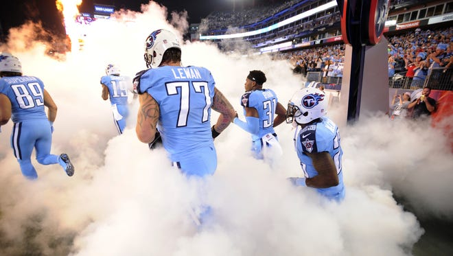 The Titans, including tackle Taylor Lewan (77), run onto the field for the game against the Jaguars on Oct. 27, 2016.