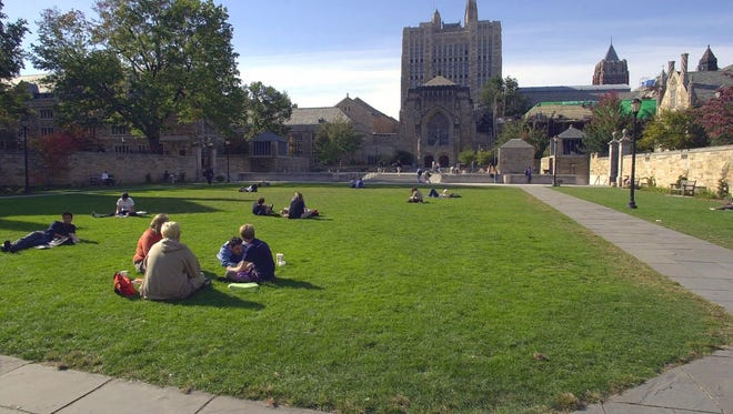 Yale University students and others spend a fall afternoon on Yale University's Cross Campus in New Haven, Conn.