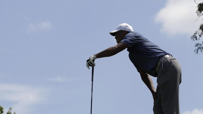 Tiger Woods watches his shot from the fifth tee during the second round of the Memorial Tournament on Friday in Dublin, Ohio.