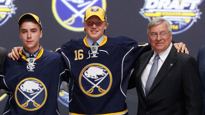 Alexander Nylander poses for a photo with Sabres owner Terry Pegula, right, after being selected as the number eight overall draft pick by the Buffalo Sabres in the first round of the 2016 NHL Draft at the First Niagara Center (KeyBank).