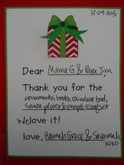 """Leigh continues the tradition of the written """"thank you"""" note with her own daughters. Though they are too young to write for themselves, they tell her what they want to say and she writes it for them. They then """"sign"""" with a handprint or a first name in print, depending on their ages."""