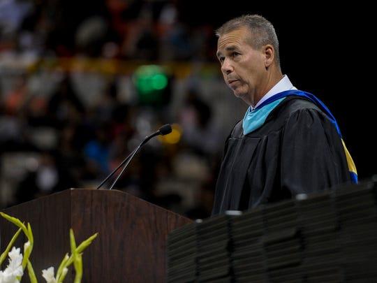 Principal David LeJeune speaks during an Acadiana High graduation ceremony.