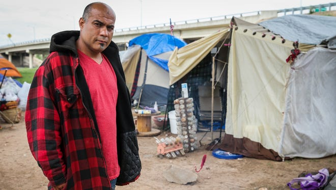 Joe Martinez stands by the community fire pit at the tent city under the Houston Harte Expressway in San Angelo. Martinez and his wife, Heidi, were camp leaders before they recently left for a new life and jobs in Arkansas.