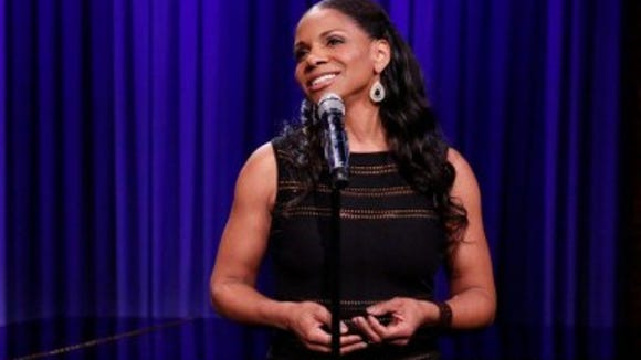 Audra McDonald sings while Jimmy Fallon accompanies her.