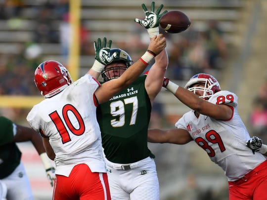 Toby McBride, shown batting down a pass in a Nov. 5 win over Fresno State, was the leading tackler among CSU's defensive linemen last season with 32. His team-leading four sacks were the most by a true freshman at CSU in at least 30 years.