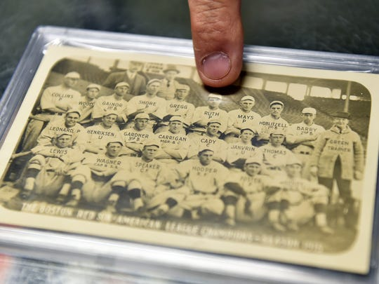 Jeff Jackson points to a rookie Babe Ruth in the back row of a 1915 Boston Red Sox postcard Thursday, May 5, 2016, at JJ's Antiques, Toys & Baseball Cards in Red Lion. Jeff Jackson, a full-time roofer who has been selling cards out of Red Lion since 1983, estimates he has 15-20 million cards between his shop, warehouse and home.