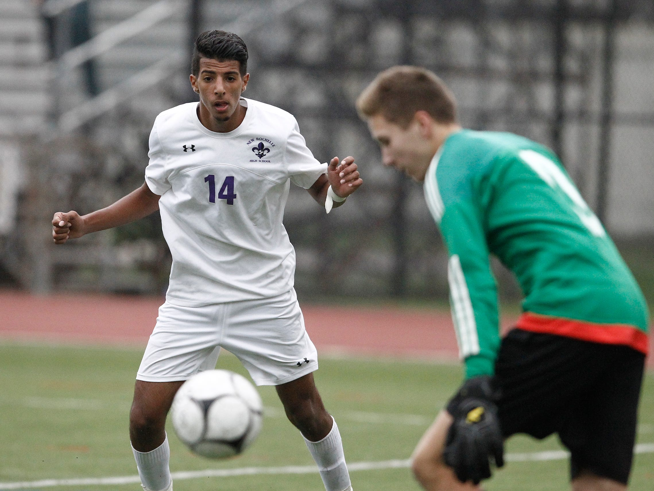 New Rochelle's Harwan Alzuabidi looks for a rebound during the Huguenots' 2-0 win over Mahopac in the first round of the boys soccer Class AA playoffs at New Rochelle High School in New Rochelle on Thursday. Alzuabidi scored both goals.