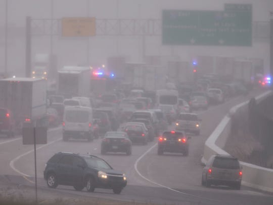 Fog and stopped traffic a few hundred meters from a multiple vehicle pileup on I-465 southbound, near the airport that snarled traffic, Indianapolis, Sunday, Feb 11, 2018.