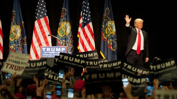 Donald Trump speaks to an audience at a rally at the