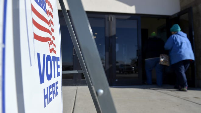 Voters drop off their ballots at Exhibition Hall on Tuesday afternoon.