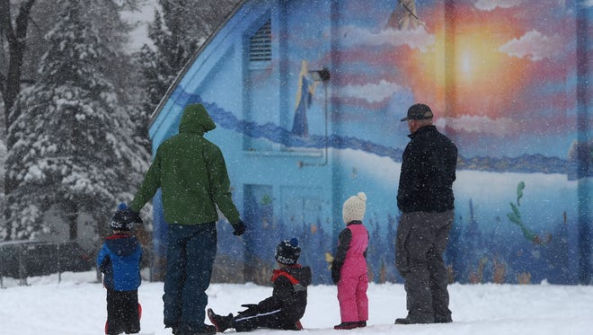 People play in the fresh snow at Plumas Park in Reno on March 16, 2018.