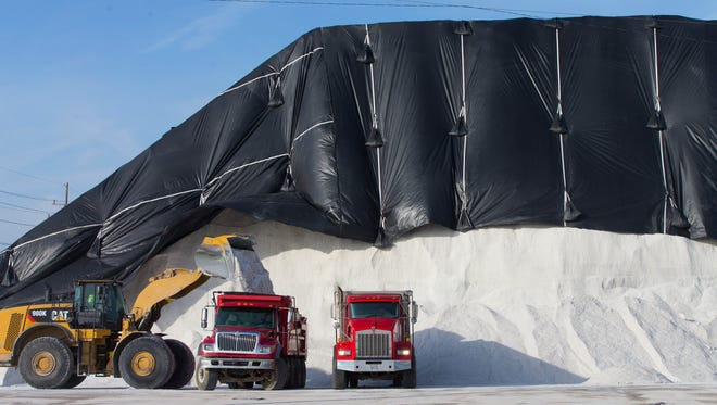 Trucks are loaded with road salt on Nov. 13 at Compass Minerals on Jones Island in Milwaukee.
