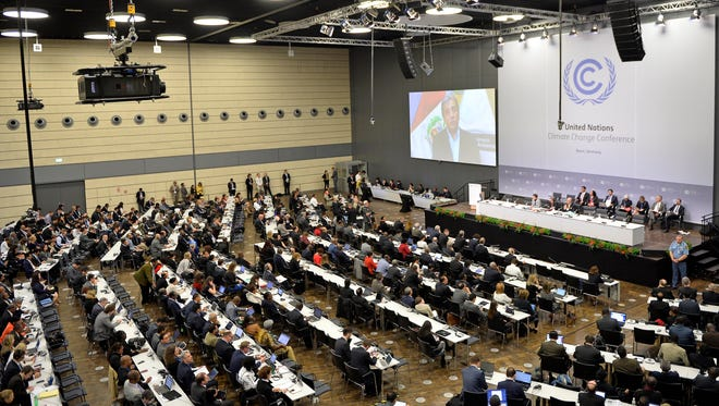 Delegates attend the United Nations Framework Convention on Climate Change in Bonn, Germany, Monday, June 1, 2015.