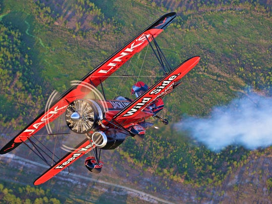 Jack Link's Screamin' Sasquatch, a 1929 Taperwing Waco bi-plane with a jet engine that allows the plane to fly vertically, flip, tumble, and do a hammerhead torque roll.