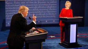 Hillary Clinton smiles as Donald Trump speaks during the presidential debate at Hofstra University in Hempstead, N.Y., on Monday. (Rick T. Wilking/Pool via AP)